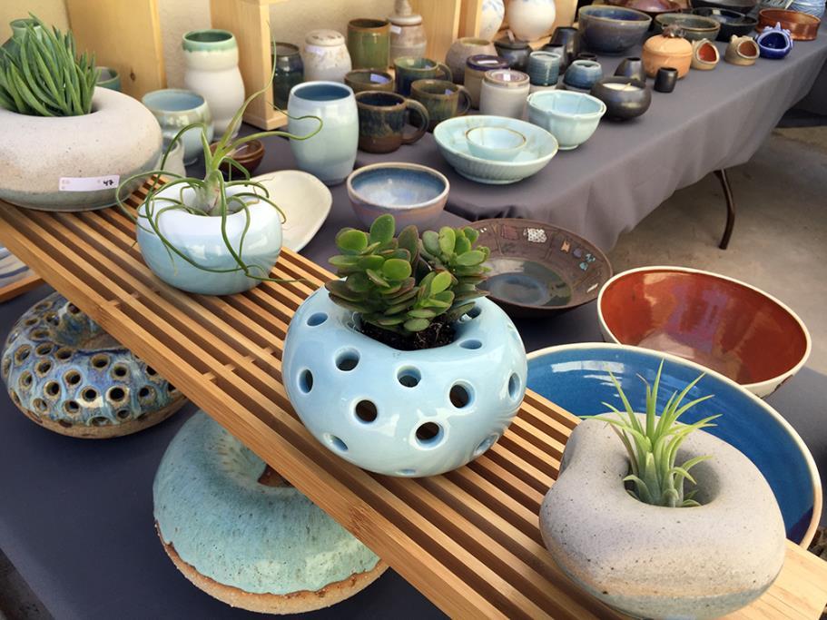 Various ceramic plates, vases, etc. made by ceramics students at the Manhattan Beach Ceramics Studio
